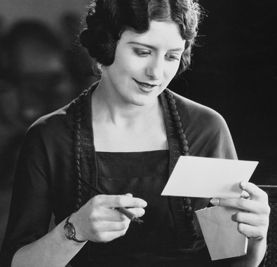 A woman reading a letter